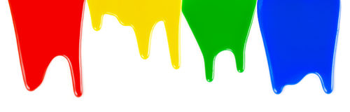 Paints dripping isolated on white Royalty Free Stock Photography