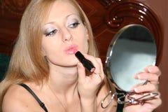 Paints lips Royalty Free Stock Photo