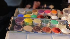The Paints Makeup Set. Professional multicolored palette brush makeup artist for cinema actor stock footage