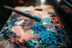 Paints mix and brush on the palette closeup view Stock Image