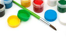 Paints with a paintbrush Stock Images