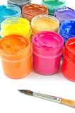 Paints and paintbrush. Multicolored gouache paints and paintbrush Stock Photo