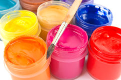 Paints and paintbrush. Multicolored gouache paints and paintbrush Stock Images