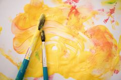 Paints and paintbrushes Royalty Free Stock Photo