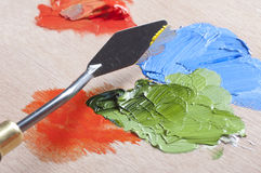 Paints and palette knife. Oil Paints and palette knife on wooden palette royalty free stock image