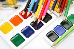 Paints and pencils Royalty Free Stock Image