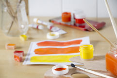 Paints in red and yellow colors Royalty Free Stock Photography