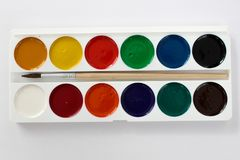 Paints. School paints with a brush royalty free stock images