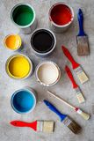 Paints in tin banks and brushes on grey stone background top view Royalty Free Stock Photography