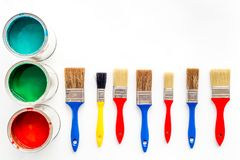 Paints in tin banks and brushes on white background top view copyspace Royalty Free Stock Image
