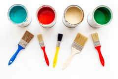 Paints in tin banks and brushes on white background top view Royalty Free Stock Photo