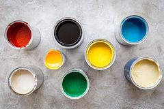 Paints in tin banks on grey stone background top view Stock Images