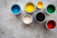 Paints in tin banks on grey stone background top view copyspace Royalty Free Stock Images