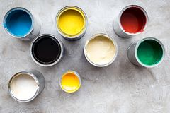 Paints in tin banks on grey stone background top view Stock Image