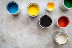 Paints in tin banks on grey stone background top view copyspace Royalty Free Stock Photo