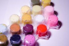 Paints. Tubes of paint. Acrylic paints. Paint cans. A wide palette of colors. Paint for drawing. Paints that create masterpieces. Painter. Paint. Palette of stock image