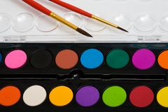 Paints and two brushes Stock Photo
