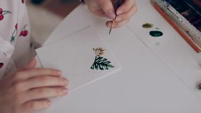 She paints in watercolor flowers, hand closeup stock video