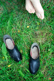 Pair. Legs and boots in a rainy summer Stock Photography