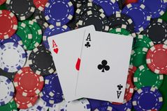 Pair of aces. Poker, hand - pocket aces on colorful chips Royalty Free Stock Photo