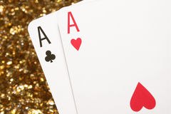 A pair of aces. A pair of aces with a glittering gold background Royalty Free Stock Photo