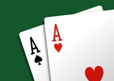 Pair of aces. On green carpet Royalty Free Stock Photography