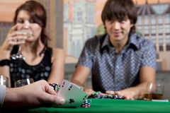 Pair of aces. In his hand poker player Royalty Free Stock Image