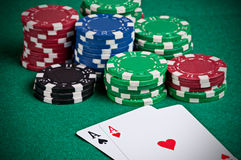 Pair of Aces. On a poker table with poker chips next to them Royalty Free Stock Photos