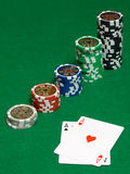 Pair of aces. On green table with chips Stock Photo