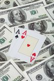 Pair of aces and american dollars Royalty Free Stock Image