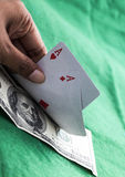 Pair of aces with $100 bill. Pair of red aces with $100 bill Royalty Free Stock Photography