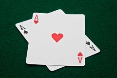 Pair of Aces on green felt Stock Image
