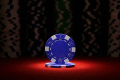 Pair of aces and poker chips on black background. Pair of aces and stack of poker chips on black background royalty free stock images