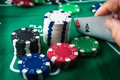 Pair of aces and poker chips royalty free stock photos