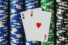 Pair of Aces on Poker Chips. Pair of Aces on a Rows of Betting Poker Chips royalty free stock photos
