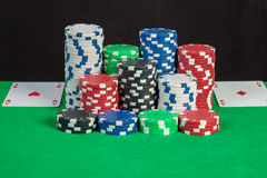 Pair aces and poker chips stack on green table Royalty Free Stock Photography