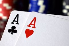 Pair of aces poker hand close up. Stacks of poker chips on background Royalty Free Stock Image