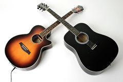 Pair of acoustic guitars. Set of acoustic guitars, one electric on white background Stock Image