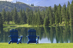 Pair of Adirondack chairs overlooking Beaufort Lake near Jasper, Canada stock photos