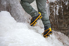 Pair of alpinist boots in crampons. On ice stock photography