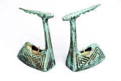 Pair of antique earthenware candle sticks stock images