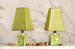 Pair of Antique Green Table Lamps with Walnuts Stock Image