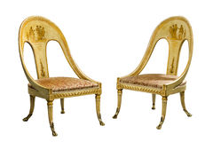 Pair antique vintage painted Egyptian style chairs isolated on w stock images