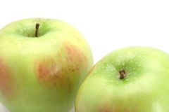 Pair of Apples. Two red and green stemed apples fresh readt to eat royalty free stock image