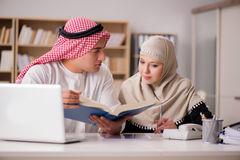 The pair of arab man and woman. Pair of arab men and woman Stock Photo