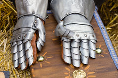Pair of armored gloves over jay bale Stock Image