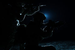 Pair of army soldiers. Attacking. Backlit contour shot Stock Photos
