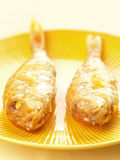A pair of asian fried fish. Close up of a pair of asian fried fish Royalty Free Stock Photo