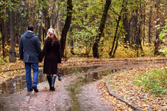 Pair in autumn park Royalty Free Stock Image