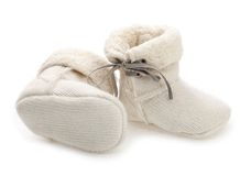 Pair of baby booties over white Stock Image